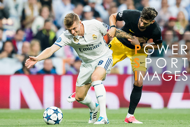 Toni Kroos (l) of Real Madrid is followed by Yannick Ferreira Carrasco of Atletico de Madrid during their 2016-17 UEFA Champions League Semifinals 1st leg match between Real Madrid and Atletico de Madrid at the Estadio Santiago Bernabeu on 02 May 2017 in Madrid, Spain. Photo by Diego Gonzalez Souto / Power Sport Images