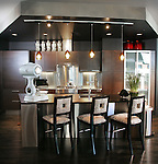The kitchen in the condo of Mickey Ackerman, an interior designer, and his partner, Richard Gilmartin, across the plaza from the Denver Art Museum.   Like the DAM, the condo building's architect is Daniel Libeskind.  Inside, Ackerman designed the decor.