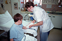 Plastering an childs broken wrist. This image may only be used to portray the subject in a positive manner..©shoutpictures.com..john@shoutpictures.com