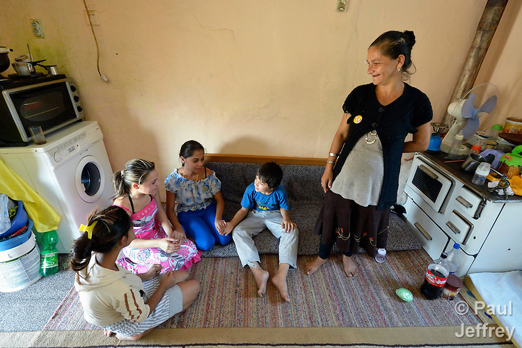 Zuhra Redjepi (right) with her children in her house in Suto Orizari, the Macedonian municipality that is Europe's largest Roma settlement. The family survives from recycling.