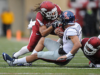 NWA Media/ J.T. Wampler - Arkansas' Alan Turner, left, and Tevin Mitchel, right, stop Ole Miss' Evan Engram in the first quarter Saturday Nov. 22, 2014.