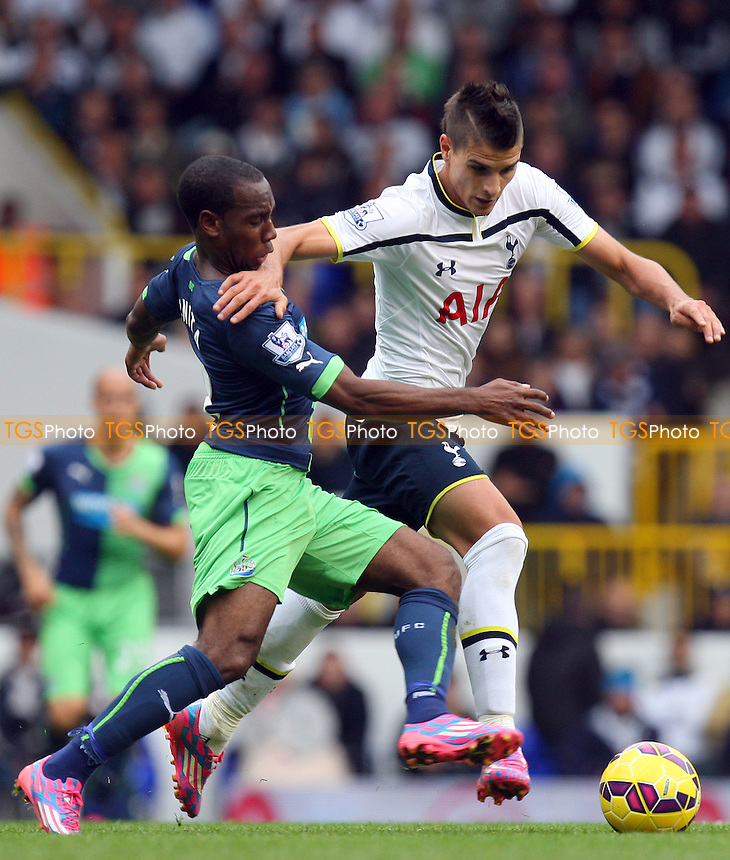Erik Lamela of Tottenham Hotspur and Vurnon Anita of Newcastle United - Tottenham Hotspur vs Newcastle United - Barclays Premier League action at the White Hart Lane Stadium on 26/10/2014 - MANDATORY CREDIT: Dave Simpson/TGSPHOTO - Self billing applies where appropriate - 0845 094 6026 - contact@tgsphoto.co.uk - NO UNPAID USE