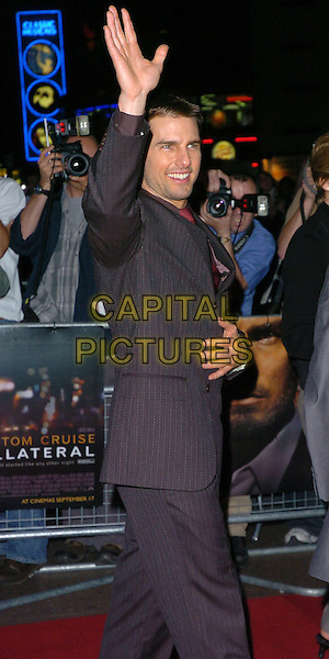 TOM CRUISE.UK Premiere of Collateral, UCI, Leicester Square.September 2nd, 2004.half length, pinstripe suit, waving, gesture.www.capitalpictures.com.sales@capitalpictures.com.©Capital Pictures