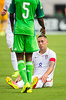 June 07, 2014:   the United States of America forward Clint Dempsey (8) looks up at Nigeria defender Efe Ambrose (5) after Ambrose knocked him to the ground during action between the USA Men's National Soccer team and Nigeria at EverBank Field in Jacksonville, Florida.  This is the last match before the USA team leaves for Brazil and the 2014 World Cup Championships. USA defeated Nigeria 2-1.
