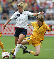 10 July 2005:   Aly Wagner of USA dribbles the ball away from Ukraine defender during the first half of the game at Merlo Field at University of Portland in Portland, Oregon.    USA defeated Ukraine, 7-0.   Credit: Michael Pimentel / ISI