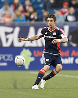 New England Revolution midfielder Stephen McCarthy (26) passes the ball. In a Major League Soccer (MLS) match, the New England Revolution tied the Columbus Crew, 0-0, at Gillette Stadium on June 16, 2012.