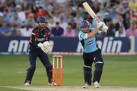 Chris Nash hits out for Sussex as James Foster looks on - Essex Eagles vs Sussex Sharks - Friends Life T20 Cricket at the Ford County Ground, Chelmsford, Essex - 28/06/12 - MANDATORY CREDIT: Gavin Ellis/TGSPHOTO - Self billing applies where appropriate - 0845 094 6026 - contact@tgsphoto.co.uk - NO UNPAID USE.