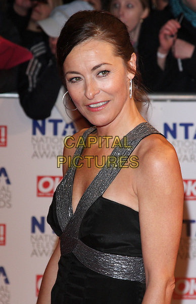 AMANDA DONOHOE .The 15th National Television Awards held at the O2 Arena, London, England. .January 20th, 2010 .NTA NTAs half length black dress silver straps.CAP/ROS.©Steve Ross/Capital Pictures.
