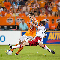 Chicago Fire defender Daniel Woolard (24) attempts to stop the strike by Houston Dynamo midfielder Geoff Cameron (20).  Houston Dynamo defeated Chicago Fire 3-2  at Robertson Stadium in Houston, TX on August 9, 2009.