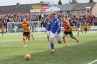 Jordan Marshall gets away from Jack McMillan in the SPFL Ladbrokes Championship football match between Queen of the South and Partick Thistle at Palmerston Park, Dumfries on  4.5.19.