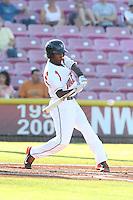 Travious Relaford #6 of the Salem-Keizer Volcanoes bats against the Spokane Indians at Volcanoes Stadium on July 26, 2014 in Keizer, Oregon. Spokane defeated Salem Keizer, 4-1. (Larry Goren/Four Seam Images)