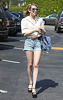 Emma Roberts wore a pair of ultra short denim shorts with tucked in silk blouse, peeptoe platforms and a trendy lilac Proenza Sohouler P1 satchel while leaving the DryBar with a drink in West Hollywood. Los Angeles, California on 19.05.2012.Credit: Vida/face to face /MediaPunch Inc. ***FOR USA ONLY***