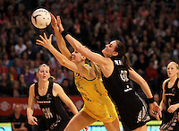 23.09.2012 Silver Ferns Leana de Bruin and Australian Caitlin Bassett in action during the third netball test match between the Silver Ferns and the Australian Diamonds at CBS Canterbury Arena in Christchurch. Mandatory Photo Credit ©Michael Bradley.