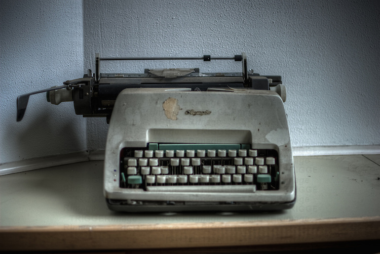 An old abandoned hospital in the former East Germany with a dirty old typewriter