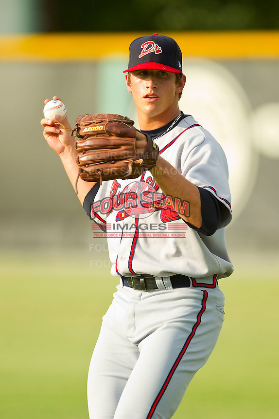 Danville Braves starting pitcher Lucas Sims (43) warms up in the outfield prior to the game against the Burlington Royals at Burlington Athletic Park on July 19, 2012 in Burlington, North Carolina.  The Royals defeated the Braves 4-3.  (Brian Westerholt/Four Seam Images)