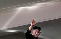 "North Korean leader Kim Jong Un waves from a balcony at the end of a mass military parade in Pyongyang's Kim Il Sung Square to celebrate 100 years since the birth of his grandfather, and North Korean founder, Kim Il Sung on Sunday, April 15, 2012. Light at top is reflection of sunlight. ""Inside DPRK"""