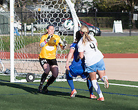Boston Breakers defender Cat Whitehill (4) and Chicago Red Stars midfielder Alyssa Mautz (4) battle for the ball as Boston Breakers goalkeeper Ashley Phillips (24) runs to intercept it.   In a National Women's Soccer League Elite (NWSL) match, the Boston Breakers defeated  Chicago Red Stars 4-1, at the Dilboy Stadium on May 4, 2013.