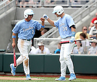 North Carolina's Chaz Frank (2) celebrates with Jesse Wierzbicki (34) after scoring a run against Vanderbilt in the first inning. Vanderbilt won 7-3 to open the 2011 College World Series in Omaha, Neb. (Photo by Michelle Bishop)..