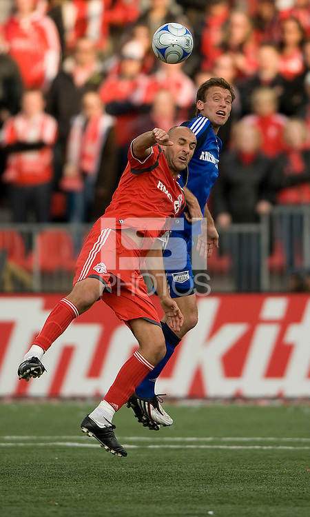 26 April 2009: Kansas City Wizards defender Jimmy Conrad #12 and Toronto FC forward Danny Dichio #9 jump for a ball during an MLS game at BMO Field between Kansas City Wizards and Toronto FC.Toronto FC won 1-0. .