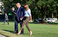 United States President Donald J. Trump waves to the press while he and first lady Melania Trump hold hands as they walk on the South Lawn of the White House in Washington, D.C., U.S., following a weekend at the Trump National Golf Club in Bedminster, New Jersey, on Sunday, August 4, 2019.    <br /> CAP/ADM/CNP/TK<br /> ©TK/CNP/ADM/Capital Pictures