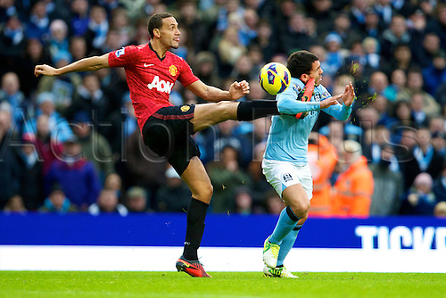 09.12.2012 Manchester, England. Manchester United's English defender Rio Ferdinand and Manchester City's Argentinean forward Carlos Tévez in action during the Premier League game between Manchester City and Manchester United from the Etihad Stadium. Manchester United scored a late winner to take the game 2-3.