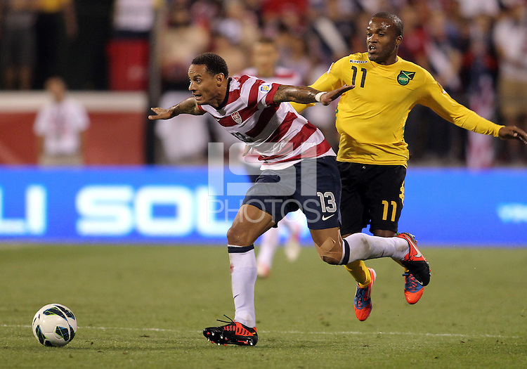 COLUMBUS, OHIO - SEPTEMBER 11, 2012:  Jermaine Jones (13) of the USA MNT blocks the ball from Dane Richards (11) of  Jamaica during a CONCACAF 2014 World Cup qualifying  match at Crew Stadium, in Columbus, Ohio on September 11. USA won 1-0.