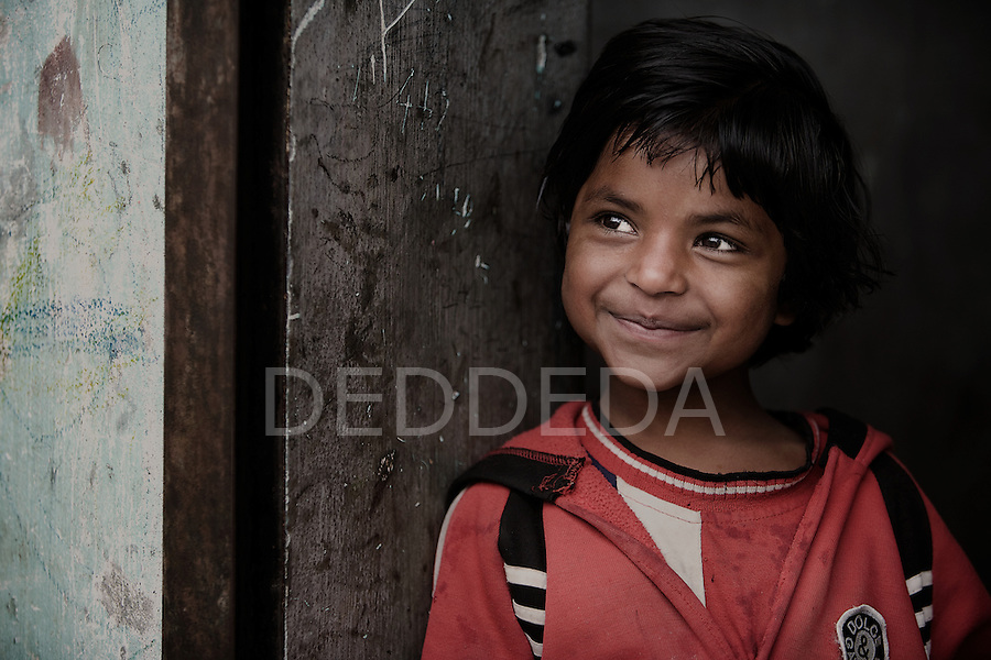 A young girl smiles at an orphanage in Pokhara, Nepal.