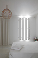 A cool guest bedroom benefits for folding shutters against the window