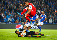 BOGOTA, COLOMBIA - MARCH 03: Goalkeeper Wuilker Farinez of Millonarios slides for the ball against Edwin Herrera of Santa Fe during the match between Millonarios and Independiente Santa Fe as part of the Liga BetPlay at Estadio El Campin on March 3, 2020 in Bogota, Colombia. (Photo by John W. Vizcaino/VIEW press/Getty Images)