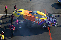 Aug 15, 2014; Brainerd, MN, USA; Crew members with NHRA funny car driver Bob Bode during qualifying for the Lucas Oil Nationals at Brainerd International Raceway. Mandatory Credit: Mark J. Rebilas-
