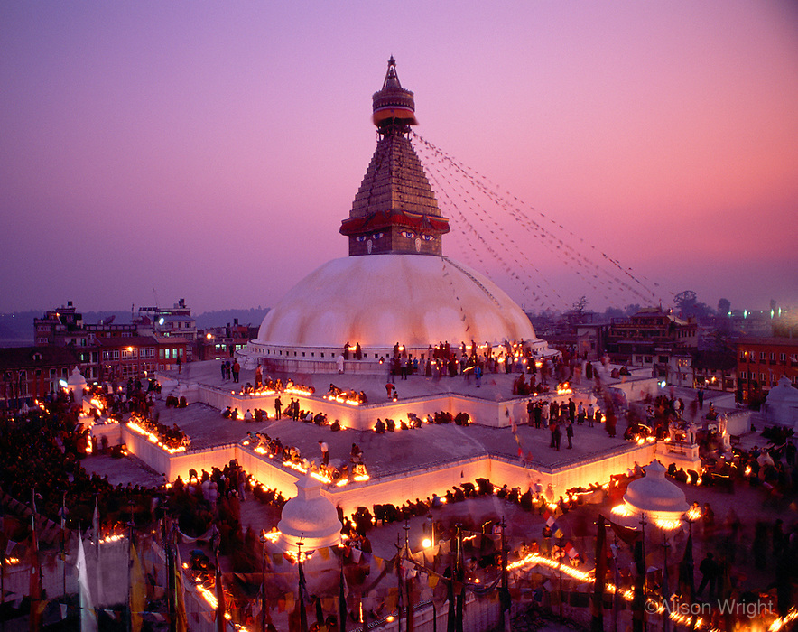 Nepal, Kathmandu. Boudhanath Stupa. 100,000 butterlamps lit for the passing of a high Tibetan Lama.