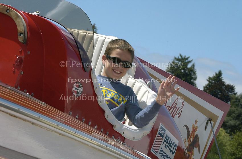 """Posing in the cockpit, U-12 """"Miss Budweiser"""" (b.1967)"""