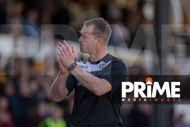Newport County manager Mike Flynn claps the fans at full time of the Sky Bet League 2 match between Newport County and Accrington Stanley at Rodney Parade, Newport, Wales on 22 April 2017. Photo by Mark  Hawkins.