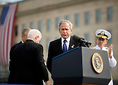 Arlington, VA - September 11, 2008 -- United States President George W. Bush prepares to speak at the dedication of the September 11th Memorial at the Pentagon on the 7th anniversary of the September 11, 2001 attacks on New York and Washington in Washington, DC, Thursday, September 11, 2008. Watching him are former Secretary of Defense Donald Rumsfeld (left) and current Secretary of Defense Robert Gates and Chairman of the Joint Chiefs of Staff Admiral Michael Mullen. .Credit: Joshua Roberts - Pool via CNP