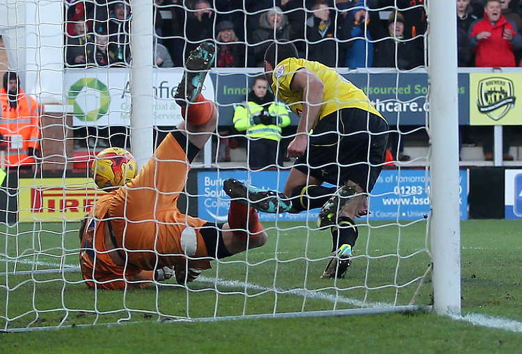 Burton Albion's Phil Edwards scores his sides first goal   beating Bury's Nick Pope<br /> <br /> Photographer Mick Walker/CameraSport<br /> <br /> Football - The Football League Sky Bet League Two - Burton Albion v Bury	 - Saturday 31st January 2015 - Pirelli Stadium - Burton upon Trent<br /> <br /> &copy; CameraSport - 43 Linden Ave. Countesthorpe. Leicester. England. LE8 5PG - Tel: +44 (0) 116 277 4147 - admin@camerasport.com - www.camerasport.com