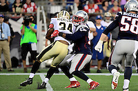 Thursday August 11, 2016: New England Patriots outside linebacker Jamie Collins (91) tackles New Orleans Saints running back Tim Hightower (34) during an NFL pre-season game between the New Orleans Saints and the New England Patriots held at Gillette Stadium in Foxborough Massachusetts. The Patriots defeat the Saints 34-22 in regulation time. Eric Canha/CSM
