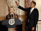 United States Secretary of State Hillary Clinton introduces President Barack Obama during the Diplomatic Corps Holiday Reception at the State Department, December 13, 2010 in Washington, DC. The State Departement was bruised by the release last month of some of the 250,000 diplomatic cables obtained by the whistleblower Web site Wikileaks.  .Credit: Chip Somodevilla - Pool via CNP