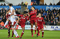 Virgil van Dijk of Liverpool heads the ball clear during the Premier League match between Swansea City and Liverpool at the Liberty Stadium, Swansea, Wales on 22 January 2018. Photo by Mark Hawkins / PRiME Media Images.