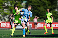 Seattle, WA - Sunday, April 17, 2016: Sky Blue FC midfielder Kelly Conheeney (24) battles for the ball with Seattle Reign FC midfielder Keelin Winters (11). during the first half of the match. Sky Blue FC defeated the Seattle Reign FC 2-1 during a National Women's Soccer League (NWSL) match at Memorial Stadium.