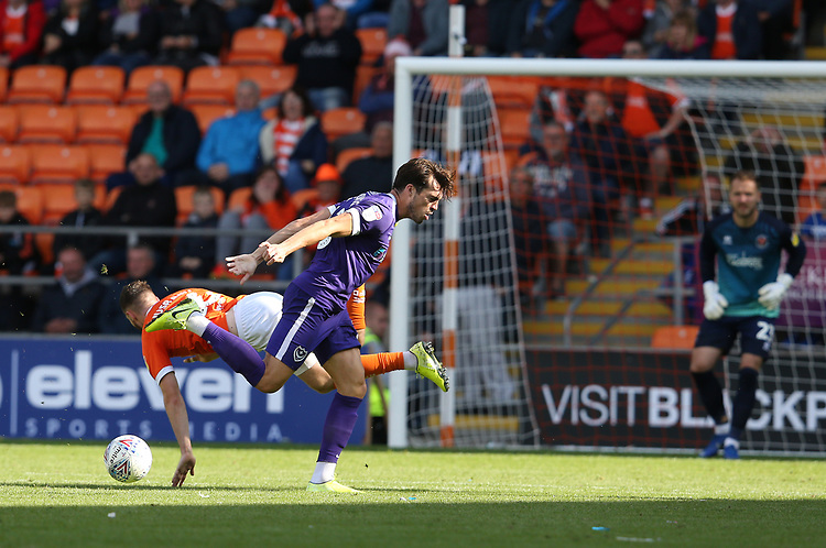 Portsmouth's John Marquis and Blackpool's James Husband<br /> <br /> Photographer Stephen White/CameraSport<br /> <br /> The EFL Sky Bet League One - Blackpool v Portsmouth - Saturday 31st August 2019 - Bloomfield Road - Blackpool<br /> <br /> World Copyright © 2019 CameraSport. All rights reserved. 43 Linden Ave. Countesthorpe. Leicester. England. LE8 5PG - Tel: +44 (0) 116 277 4147 - admin@camerasport.com - www.camerasport.com