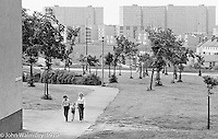 Contrast between large open areas and huge blocks of flats, Wester Hailes, Scotland, 1979.  John Walmsley was Photographer in Residence at the Education Centre for three weeks in 1979.  The Education Centre was, at the time, Scotland's largest purpose built community High School open all day every day for all ages from primary to adults.  The town of Wester Hailes, a few miles to the south west of Edinburgh, was built in the early 1970s mostly of blocks of flats and high rises.