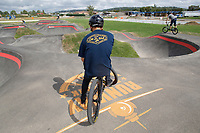 NWA Democrat-Gazette/DAVID GOTTSCHALK Daiki Shimogaki, of Japan, surveys Tuesday, October 9, 2018, the pump track at the Runway Bicycle Skills Park at the Jones Center in Springdale. The park will host the Pump Track (bicycling) World Championships sponsored by Red Bull on Saturday, October 13. A pump track is designed so that bikers pump and push on hills and turns to build speed using their upper body and hips instead of pedaling.