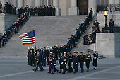 A military casket team prepare to carry the casket of former President George. H. W. Bush to the Capitol Rotunda in Washington, DC where he will lie state, December 3, 2018. Credit: Chris Kleponis / CNP