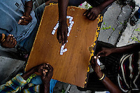 Haitian men play dominoes on the street of Port-au-Prince, Haiti, 7 July 2008.
