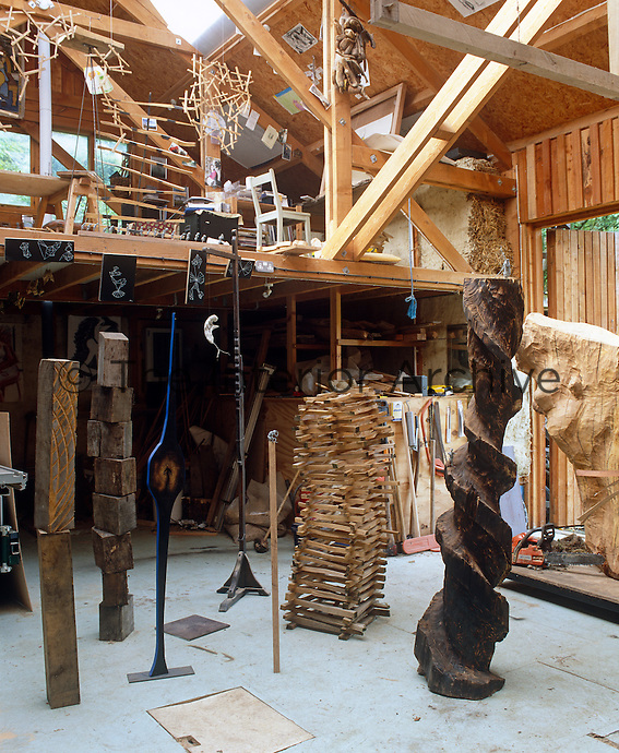 Sculptor Henry Brudenell-Bruce's studio with a number of his wooden sculptures