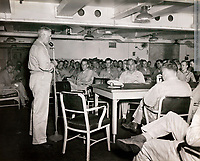 Carrier Air Group 85 pilots in meeting with Capt. James D. Barner on the Shangri-La a day before a midnight wake up and dropping 300 bombs on Tokyo airfields  - July 9, 1945