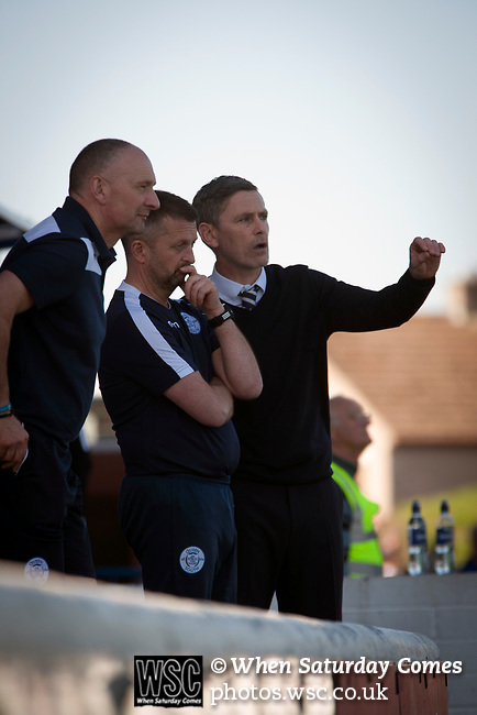 Home manager Gary Naysmith consults with his coaching staff during the second-half at Palmerston Park, Dumfries as Queen of the South hosted Dundee United in a Scottish Championship fixture. The home has played at the same ground since its formation in 1919. Queens won the match 3-0 watched by a crowd of 1,531 spectators.