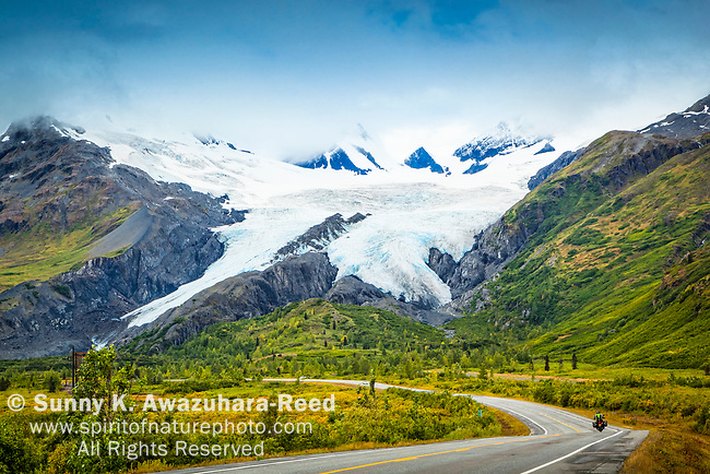 Worthington Glacier with a biker on Richardson Hwy. Valdez, Southcentral Alaska, Autumn.