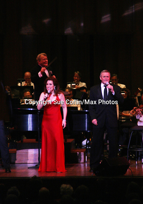 Debbie Gravitte and Ron Raines perform Jerry Herman's Broadway with the National Symphony Orchestra at The John F. Kennedy Center for Performing Arts on March 14, 2009, in Washington D.C. (Photo by Sue Coflin/Max Photos)
