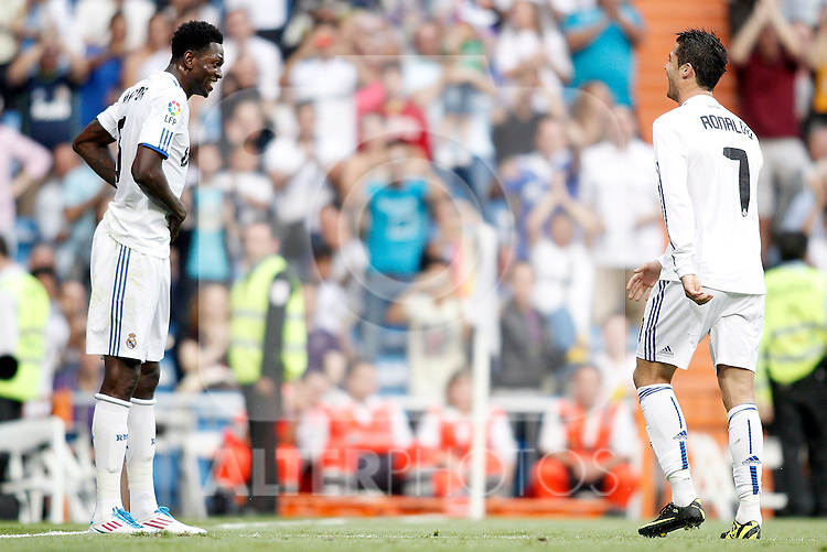 Real Madrid's Emmanuel Adebayor celebrates with Cristiano Ronaldo during La Liga Match. May 21, 2011. (ALTERPHOTOS/Alvaro Hernandez)